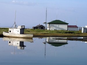 Herschel Island, a quiet pond, an old fishing boat, the old Canadian Signal Corps building--amazing photo by incredible photographer Hank Moorlag