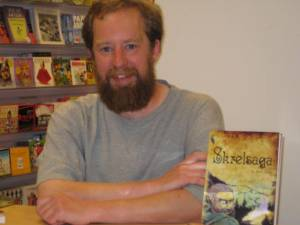 Steve Parker looking pretty satisfied next to his book, Skrelsaga.  He lives to autograph!